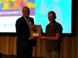 Scott Johnston, left, presents Shiloh Shulte of the American Oystercatcher Working Group the Conservation Leadership Award.
